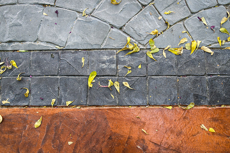Stamped Concrete vs. Pavers: What To Choose for Your Tulsa Home or Office Landscape